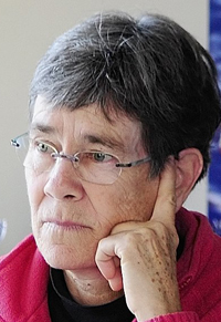 MaineHousing executive director Dale McCormick listens to a conference call on Friday morning in her Augusta office. File photo