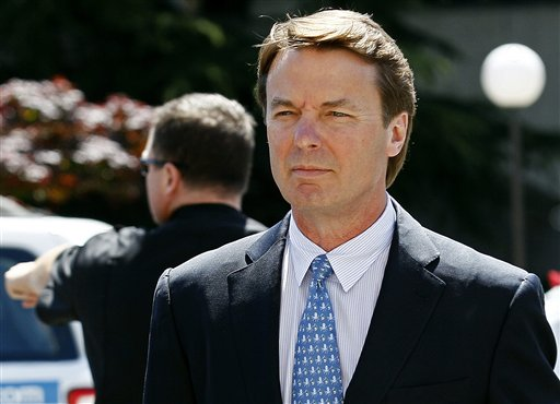 FILE - In this April 12, 2012, file photo, former presidential candidate and U.S. Sen. John Edwards arrives outside federal court in Greensboro, N.C. Andrew Young retook the witness stand for a fourth straight day at Edwards� criminal trial in a North Carolina courthouse over accused campaign finance violations on Thursday, April 26, 2012. The former aide was the first witness called by the prosecution and is key to making the government�s case that Edwards directed a scheme to use nearly $1 million in secret payments from two wealthy donors used to help hide his pregnant mistress as he campaigned for the White House in 2008. Edwards has pleaded not guilty to six criminal counts and faces up to 30 years behind bars if convicted. (AP Photo/Gerry Broome, File)