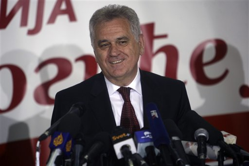 The nationalist Serbian Progressive Party leader, and presidential candidate, Tomislav Nikolic, talks to members of the media at a press conference in Belgrade, Serbia, Sunday, May 6, 2012. A pro European Union candidate and a nationalist opponent are headed for a runoff in Serbia's presidential elections, while the ruling pro Western party is likely to form the next coalition government, independent pollsters said Sunday. (AP Photo/ Marko Drobnjakovic)