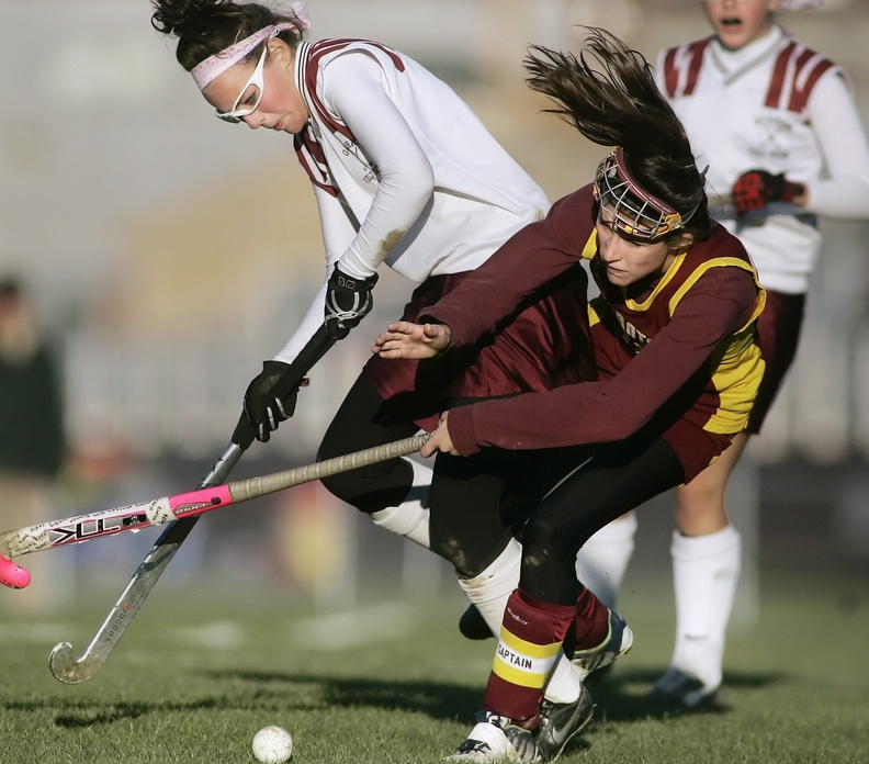 Kelly Van Clief of Thornton Academy, right, collides with Kayleigh Ballantyne of Gorham during a game in 2008. Some coaches say wearing goggles increases the risk of collisions because it restricts a player's vision.