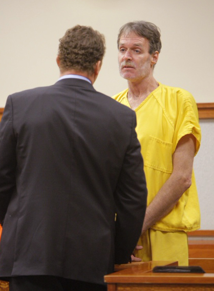 Brian Kelley talks to his lawyer, Peter Cyr, in Superior Court today.