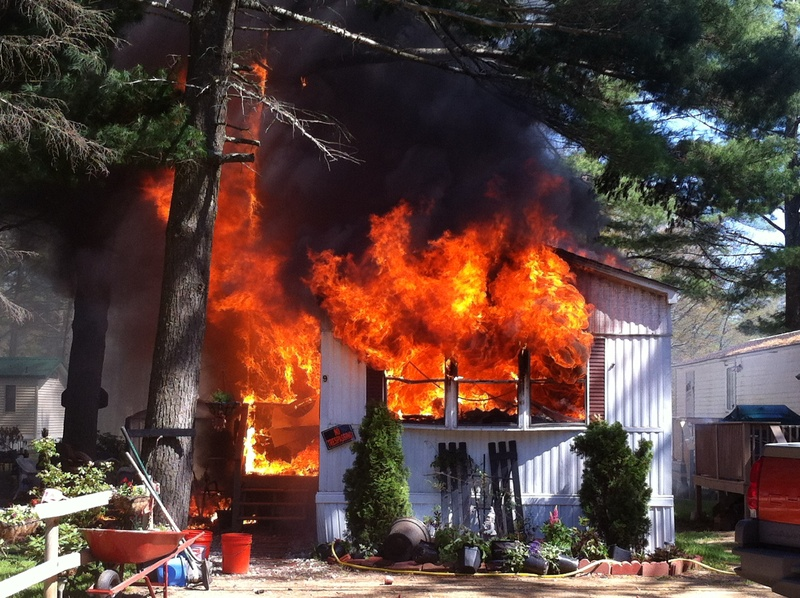 Flames shoot from a mobile home at Evergreen Mobile Home Park in Lebanon on Saturday.