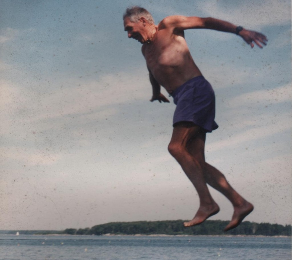 Robert 'Hap' Hazzard jumps from rocks near his camp on Moshier Island in Casco Bay.