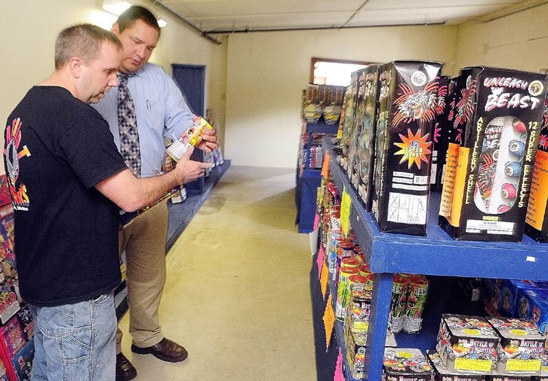 Co-owner Tim Bolduc, left, talks to customer David Godfrey about some of the products at Patriot Fireworks in Monmouth.