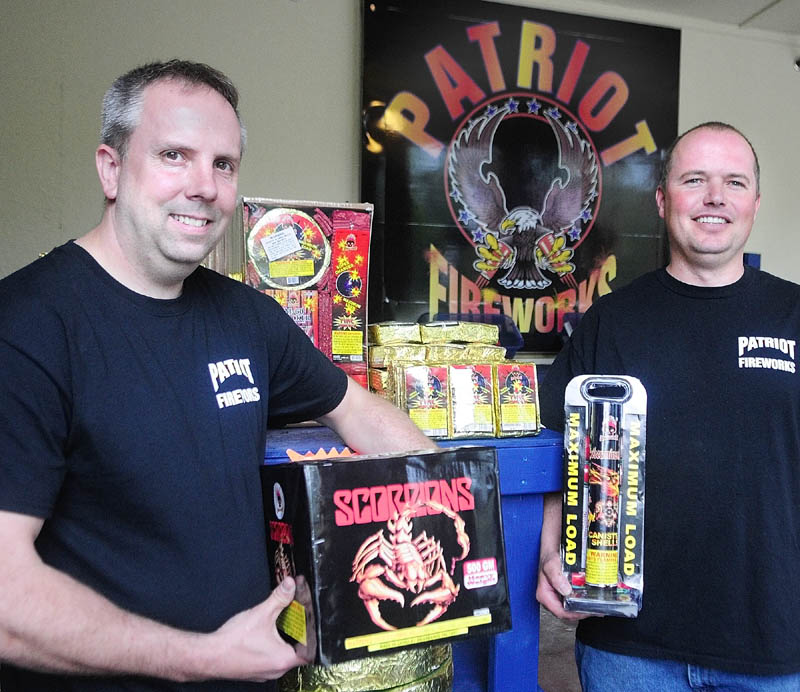 Tim Bolduc, left, and Jay Blais recently opened Patriot Fireworks in Monmouth.