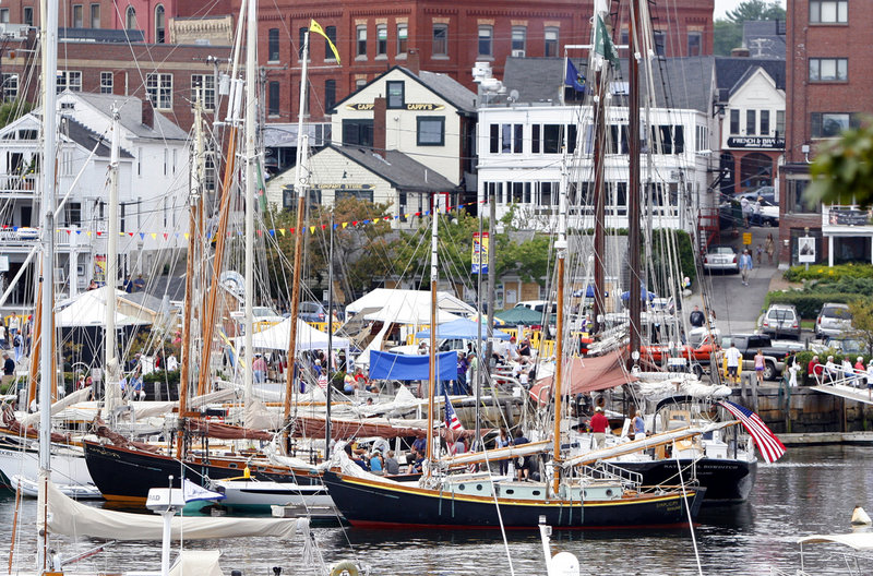 In this September 2011 photo, windjammers are docked in Camden harbor. A new US postmark will feature a Maine windjammer theme.