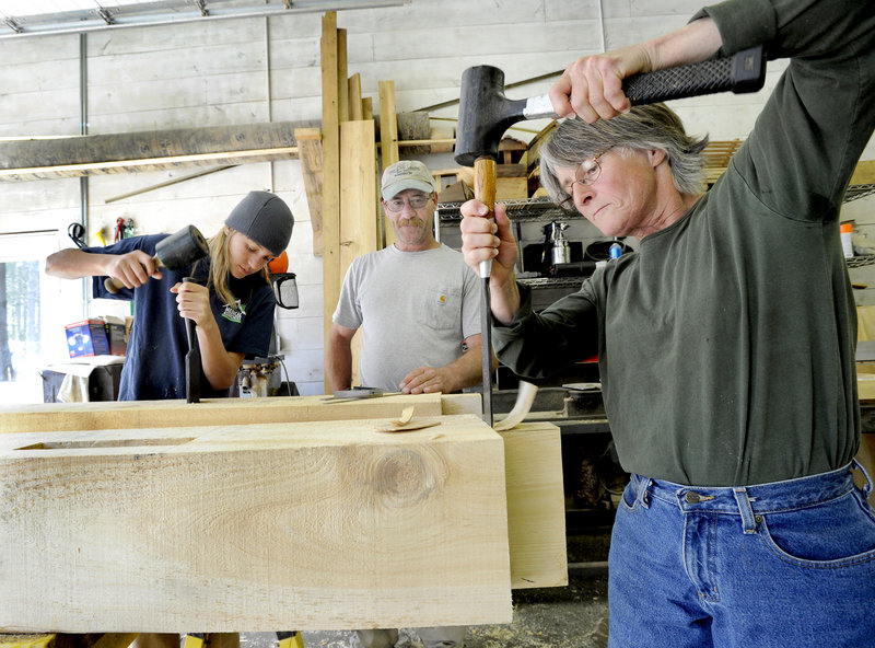 Bob Lear, middle, keeps his eyes on Hidden Valley Nature Center timber framing students Jane Conley, right, and Sebastian Crocetti.