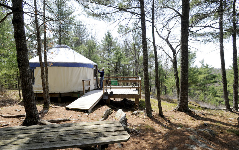 Tracy Moskovitz opens a yurt at the Hidden Valley Nature Center in Jefferson. Visitors can stay in the yurt, though the center suggests a donation of $70 for two people.
