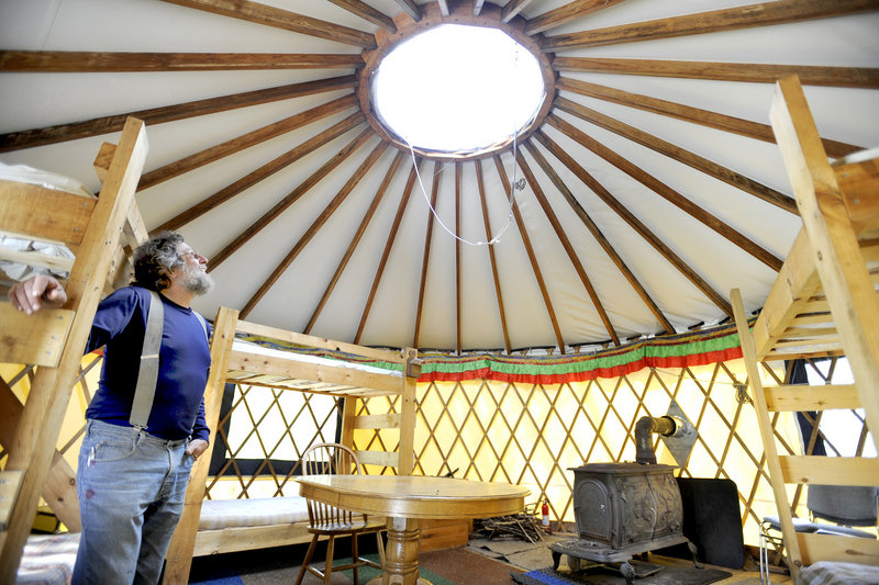 Tracy Moskovitz looks through a skylight inside a yurt. The center also has a pair of huts that visitors can rent, as well as campsites and canoes.