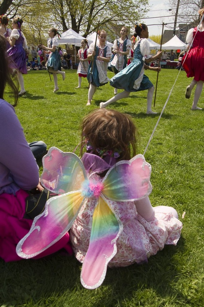 A young fairy takes in the maypole dancing during last year's May Day Festival in Kennebunk.