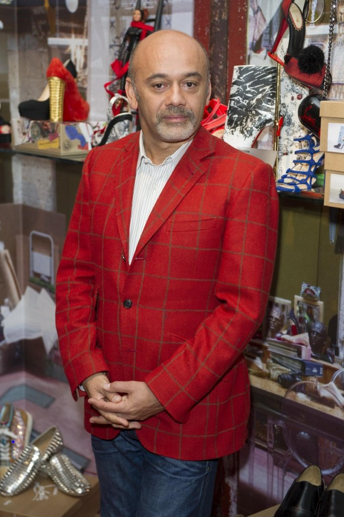 At the Design Museum in London on Monday, Christian Louboutin helps open an exhibition showcasing how he transformed the design of the shoe over the past 20 years.