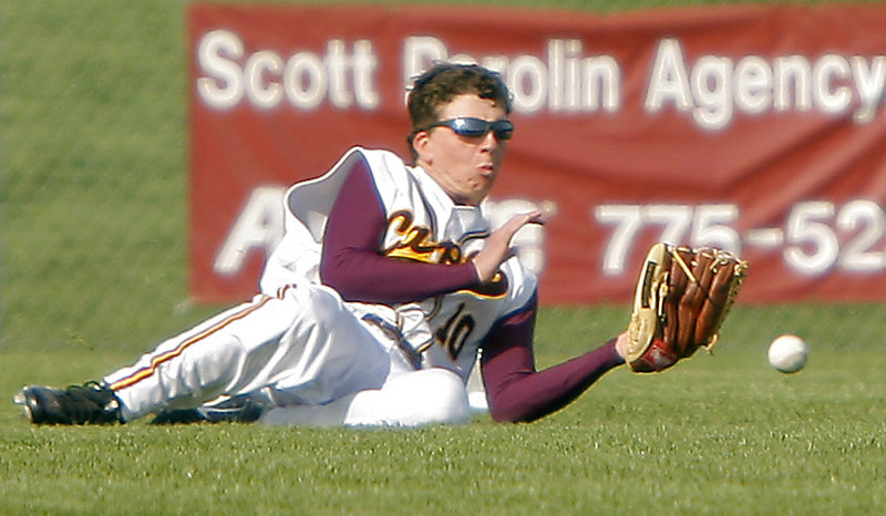 Connor Maguire of Cape Elizabeth can't get to the ball in time to make the catch in right field Monday during an 8-0 loss to Greely.