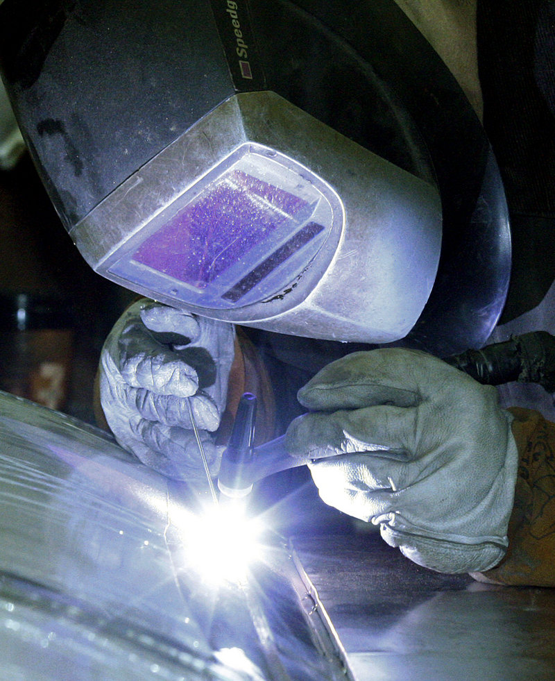 A workman welds a stainless steel tank at JV Northwest in Camby, Ore. U.S. factories stepped up hiring and production in April.