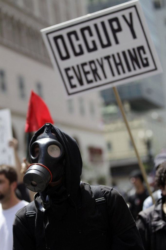 A demonstrator in Oakland, Calif., marches wearing a gas mask Tuesday, as hundreds of activists across the U.S. joined the worldwide May Day protests.
