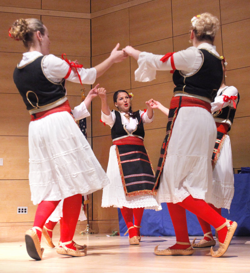 The group Sokolica, a Serbian folk dance ensemble, performs a dance during the Multicultural and International Graduation Celebration at the University of Southern Maine in Portland on Tuesday night. Students and officials from the University of Southern Maine, the University of New England and Southern Maine Community College participated in the celebration recognizing the achievements of the schools' multicultural student population.