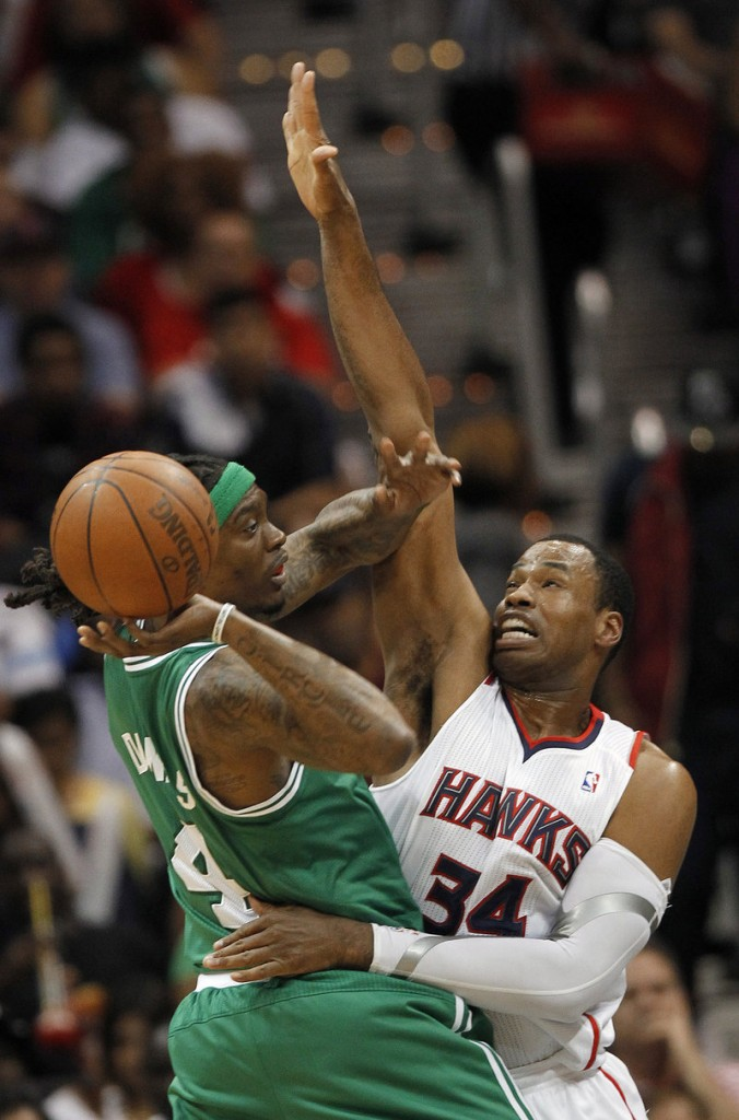 Marquis Daniels of the Celtics looks for an open teammate as Atlanta's Jason Collins defends in Game 2 of the Eastern Conference quarterfinals Tuesday. Playing without Rajon Rondo, Boston rallied for an 87-80 win.