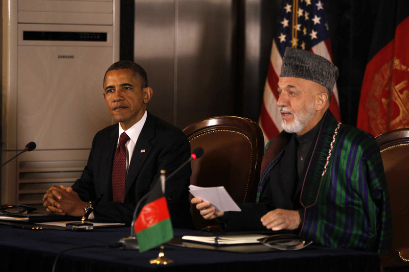 President Obama and Afghan President Hamid Karzai speak before signing a strategic partnership agreement at the presidential palace in Kabul, Afghanistan, on Wednesday.