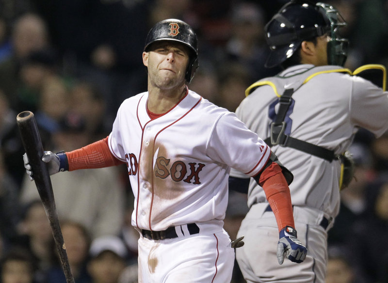 Dustin Pedroia shows his frustration after striking out in the sixth inning against Oakland on Wednesday night at Fenway Park. The Red Sox lost 4-2, dropping 2 of 3 to the Athletics.