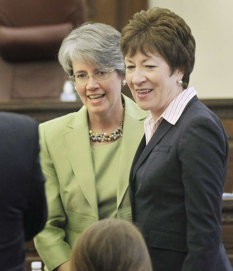 Nancy Torresen, left, introduces her relatives to Maine Sen. Susan Collins before Torresen was sworn in as a district judge at the federal courthouse in Portland. Political and judicial luminaries were well represented at the event.