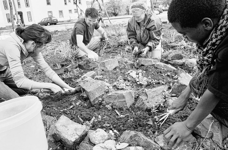 Gardeners prepare a bed for perennial herbs at the Boyd Street Community Garden in Portland in 2009. A city working group is identifying other parcels that could be community garden space, a reader says.