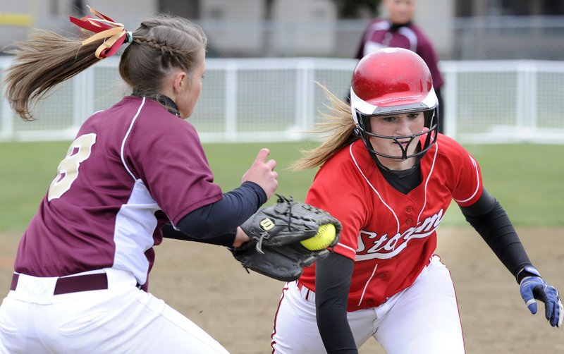 Alyssa Williamson of Scarborough is tagged out by Thornton Academy pitcher Julia Geaumont after being caught in a rundown Thursday.