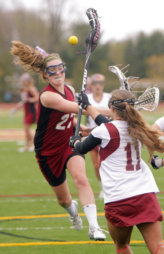 Lindsey Smith of Gorham gets off a shot while being defended by Nicole Moore of Thornton Academy during their game at Saco.