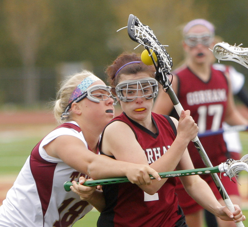 Kali St. Germain of Gorham is closely defended by Thornton Academy's Camilla Olsson in a lacrosse game Thursday in Saco. St. Germain scored four goals, and Gorham rallied for an 11-10 win.