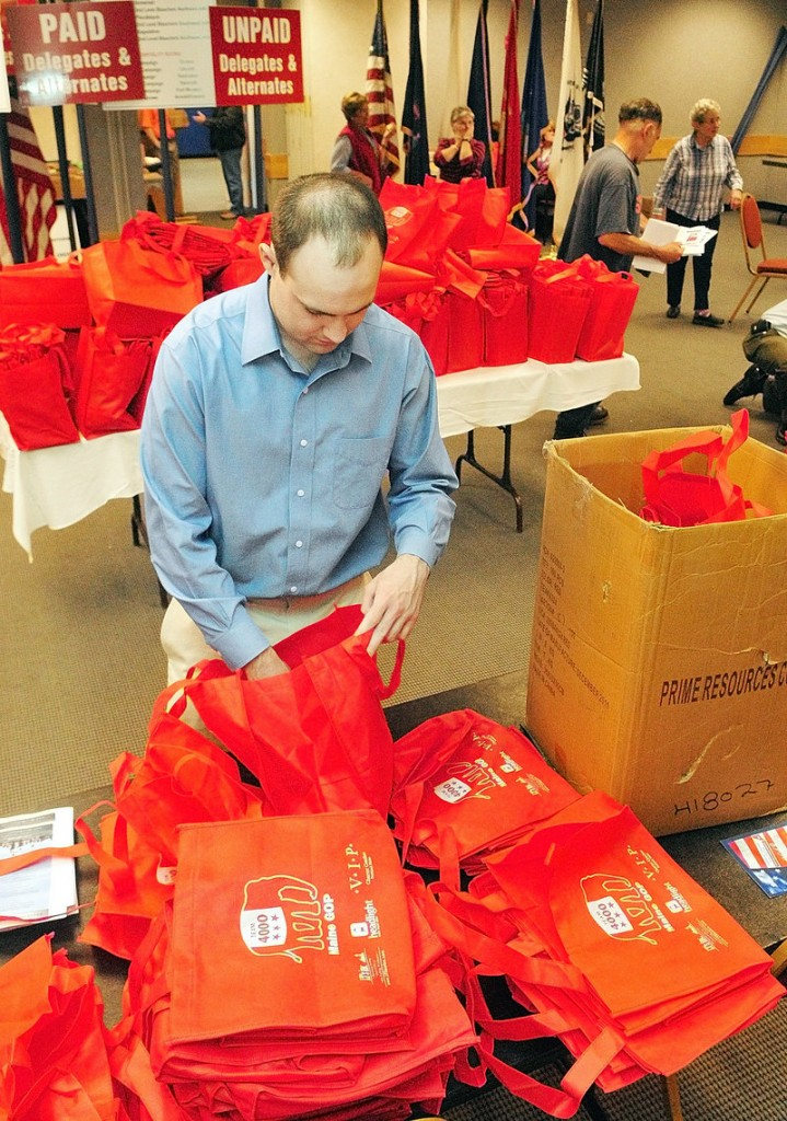 John McMahon, a volunteer for the Mitt Romney campaign from New Hampshire, on Friday puts leaflets into bags that will be given to GOP state convention delegates.