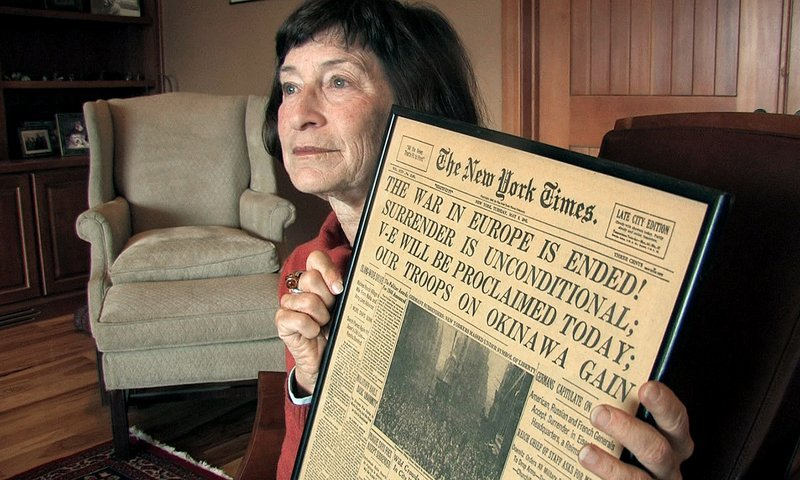 Julia Kennedy Cochran, daughter of former Associated Press Paris bureau chief Edward Kennedy, holds a copy of The New York Times published on May 8, 1945, at her home in Bend, Ore., on Wednesday.