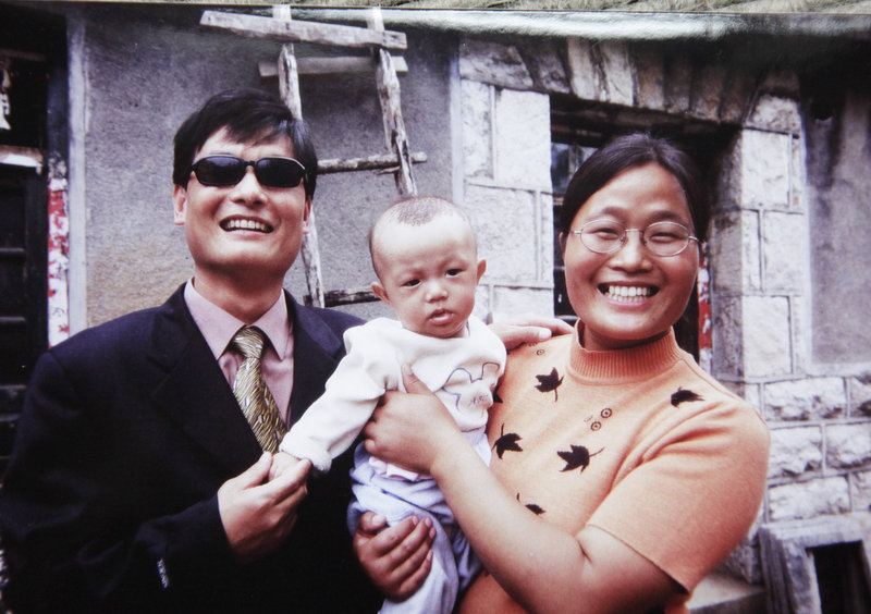 Chinese legal activist Chen Guangcheng and his wife, Yuan Weijing, hold their son in Shandong province. The United States and China forged the outlines of a deal Friday to end a diplomatic standoff over Chen that would let him travel to the United States with his family for a university fellowship.