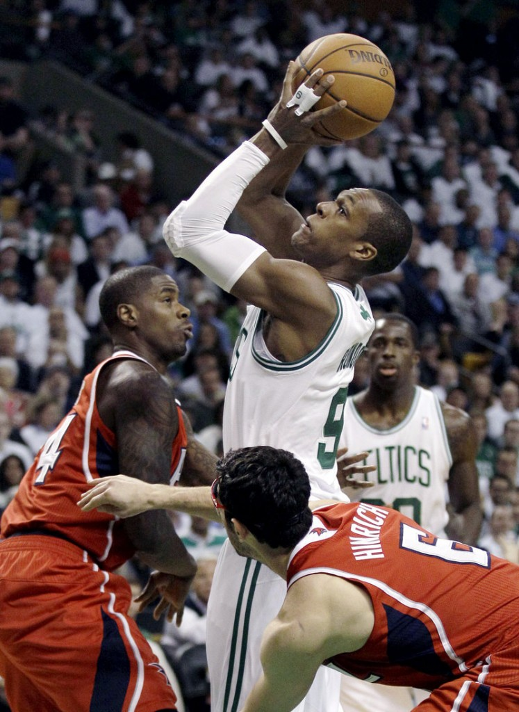 Rajon Rondo drives between Atlanta's Marvin Williams, left, and Kirk Hinrich during Game 3 of the Eastern Conference quarterfinals Friday. Rondo had 17 points, 14 rebounds and 12 assists in a 90-84 overtime win.