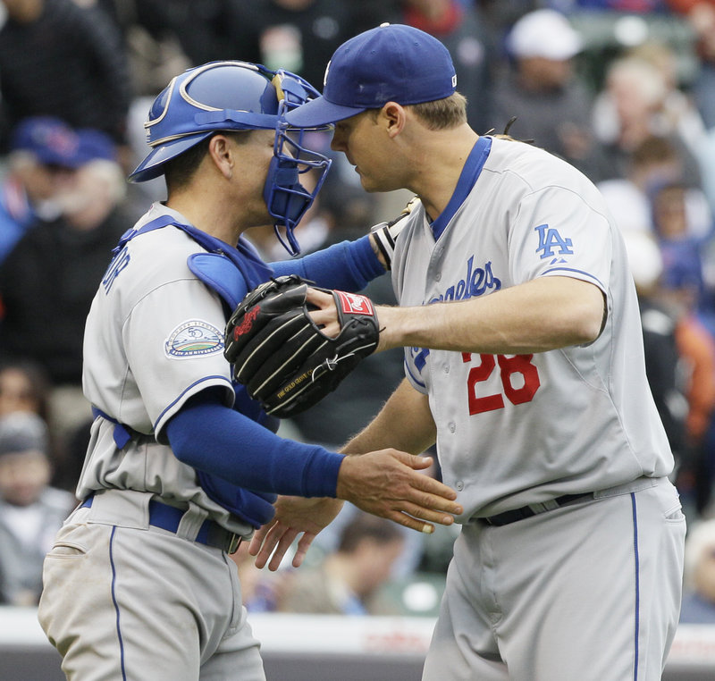 Jamey Wright and catcher Matt Treanor celebrate after the Dodgers beat the Cubs 5-1 Saturday at Chicago.