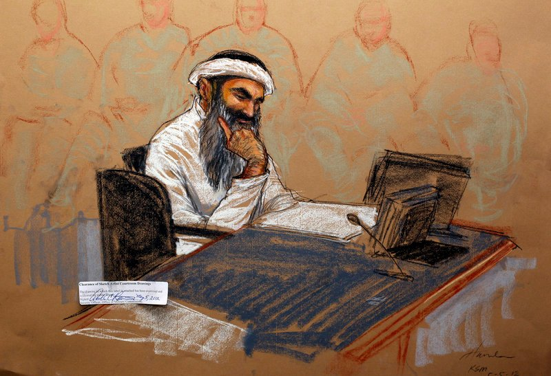 In courtroom artist's sketch, Khalid Sheikh Mohammed, the self-proclaimed mastermind of the Sept. 11 attacks, reads a document during his military hearing at the Guantanamo Bay Naval Base in Cuba on Saturday.