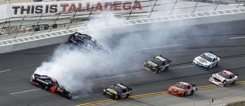 The Nationwide race on Saturday featured several accidents, including this one involving Danny Efland, 4, and Mike Wallace, 01, on Turn 4 at Talladega Superspeedway. Joey Logano nipped Kyle Busch for the win.