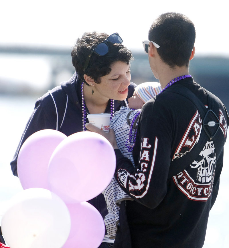 Miranda Wannemacher of Portland leans in to kiss her son, Levi, 6 weeks old, as she and her husband, Caleb, participate in the walk. As new parents, they felt inspired to walk in support of others.