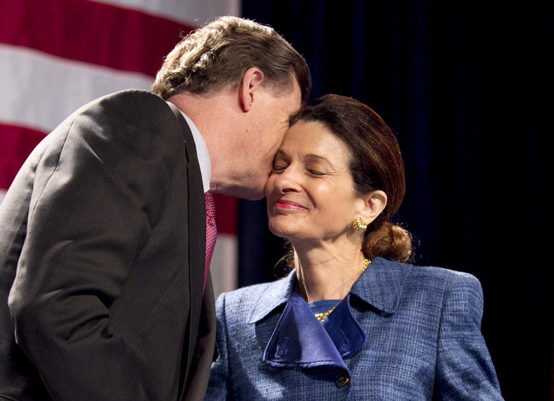 Sen. Olympia Snowe, R-Maine, gets a kiss from her husband, John R. McKernan, following her speech at the Maine Republican State Convention on Sunday, May 6, 2012. (AP Photo/Robert Bukaty)