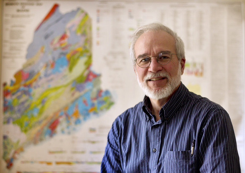 State geologist Robert Marvinney shows a bedrock geologic map of Maine. A bill signed last month sets in motion an overhaul of two-decades-old state mining regulations.