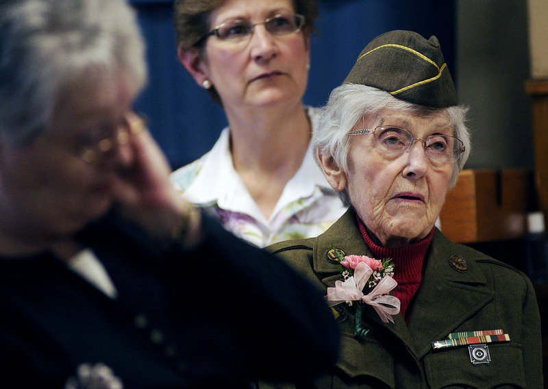 Norma Doody of Westbrook looks on during the State of Maine Silver Commemorative Coin presentation at the Maine Veterans Home in Scarborough on Monday. Doody received the coin for her service in the Army during World War II.