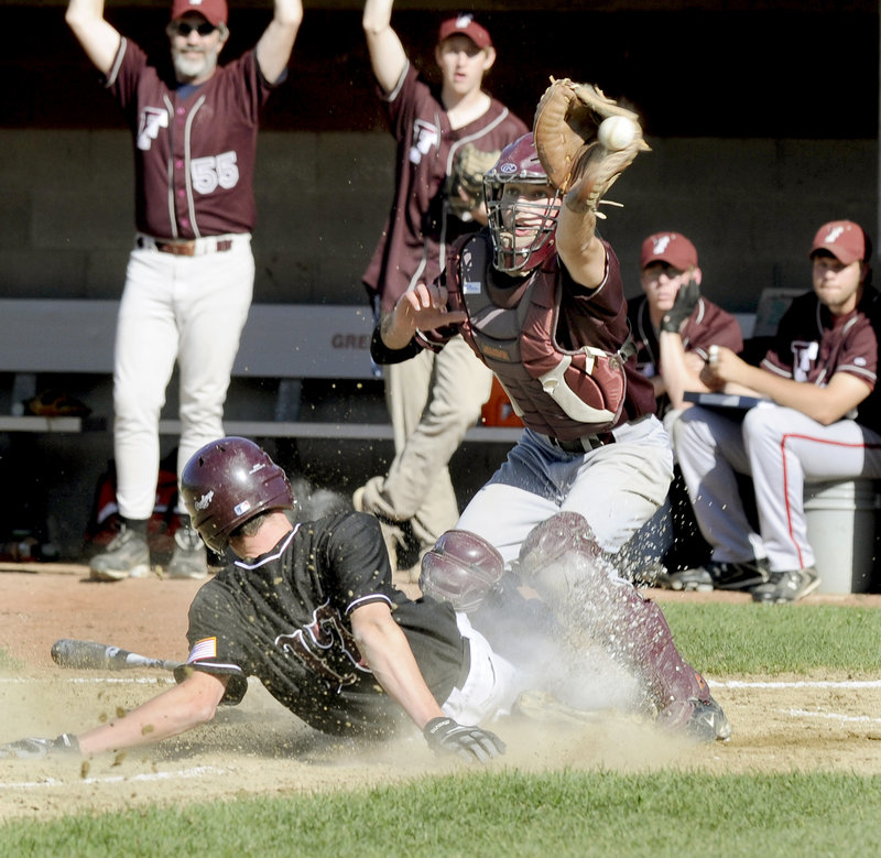 Sam Porter of Greely slides safely across the plate as Freeport catcher Jared Knighton can't handle the throw in the third inning of Monday's game in Cumberland. Two runs scored on the play, and Greely went on to a 4-2 win.