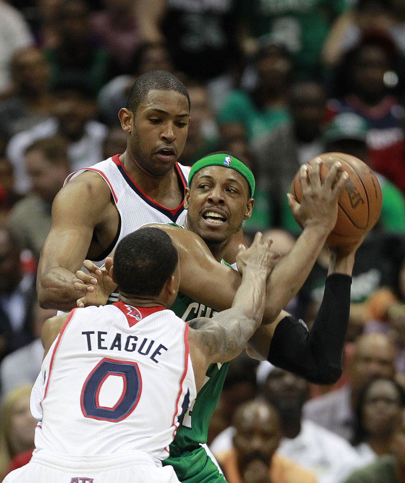 Paul Pierce of the Boston Celtics looks for room Tuesday night while hemmed in by Jeff Teague and Al Horford of the Atlanta Hawks. Atlanta won, 87-86.