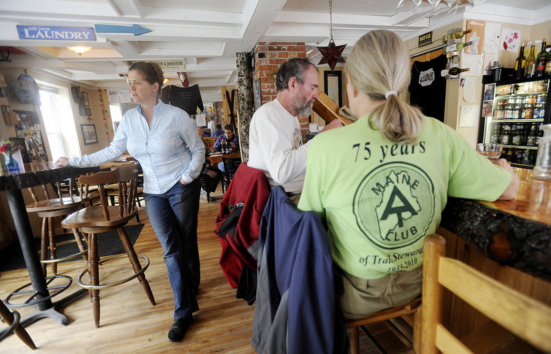 Rebekah Anderson, left, is the owner of Lakeshore House, the only pub in Monson. Anderson and her fellow townspeople have gone out of their way for years to help hikers on the Appalachian Trail, and aid in any problems that might arise.