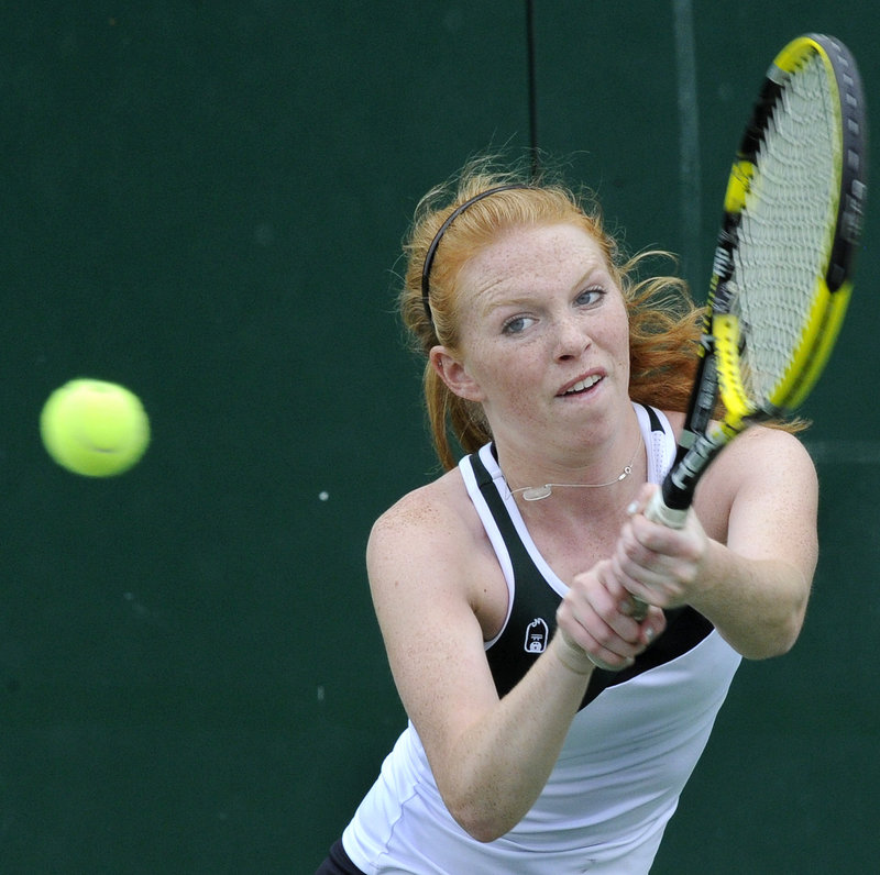 Addie Devine of McAuley returns a shot Wednesday during her victory against Maria Cianchette of Cheverus.