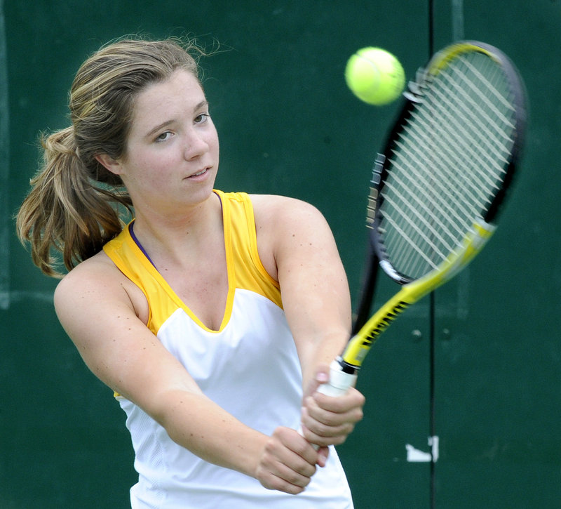 Maria Cianchette of Cheverus keeps her eye on the ball during a return in the match against McAuley.