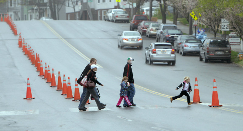 Pedestrians cross Park Avenue in Portland near Hadlock Field on Wednesday. Work on sections of Park Avenue and St. John Street is expected to begin after Labor Day.