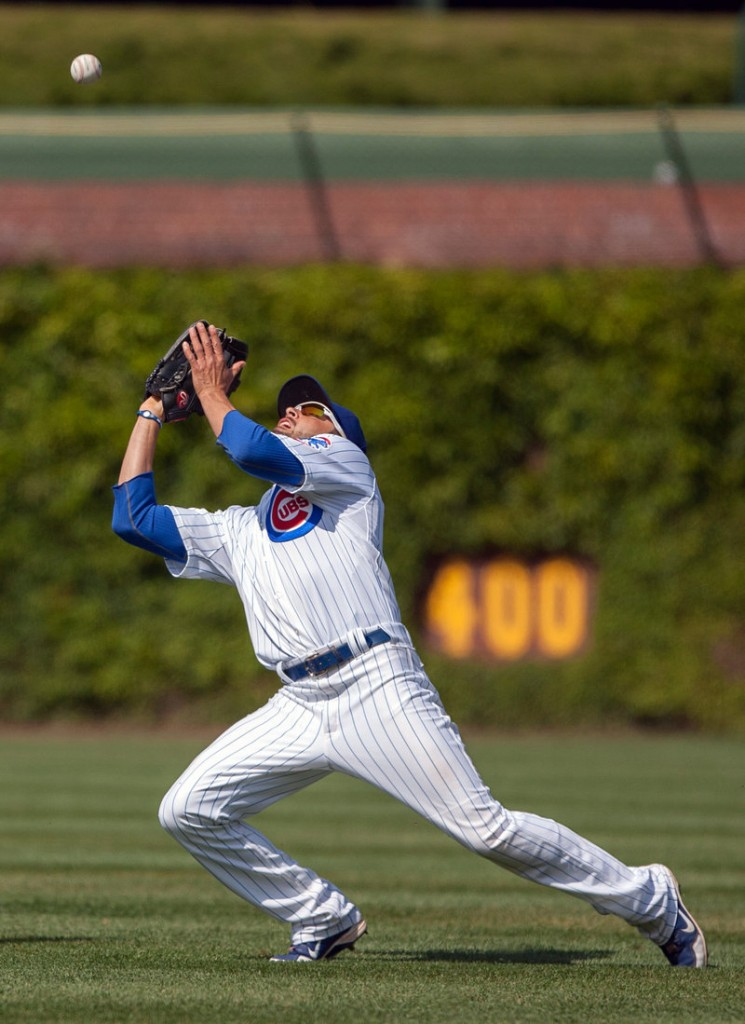 David DeJesus of the Cubs catches a fly ball in the seventh inning Wednesday afternoon at Chicago. The Cubs beat the Braves, 1-0.