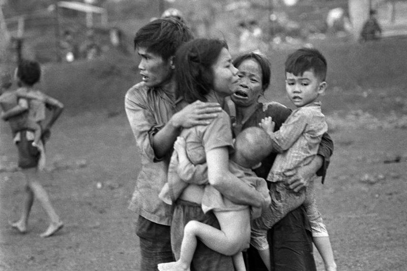 Associated Press photographer Horst Faas shot this picture in June 1965 of South Vietnamese civilians, among the few survivors of two days of heavy fighting, huddled together in the aftermath of an attack at Dong Xoai, Vietnam.
