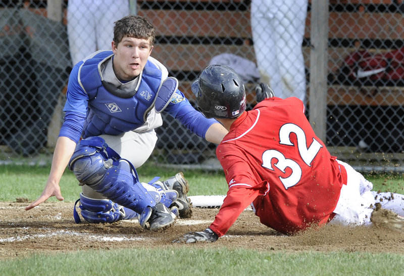 Lake Region catcher Tucker Irish makes the tag Thursday as Dan Quint of Wells slides into the plate during their Western Maine Conference baseball game at Naples. Wells earned a 5-3 victory.