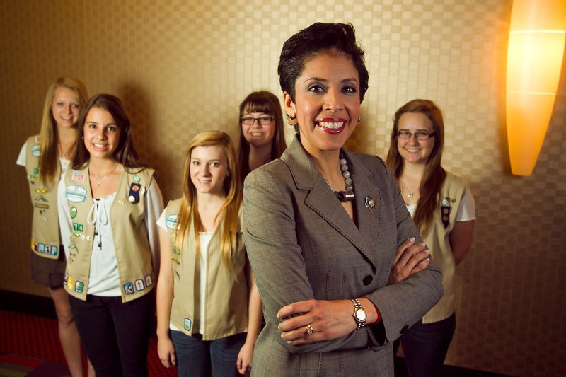 "Anna Maria Chavez, Girl Scouts CEO, stands with scouts from Phoenix, Ariz. ""Our world is becoming smaller,"" she said, ""and our young people need ... to engage with peers."""