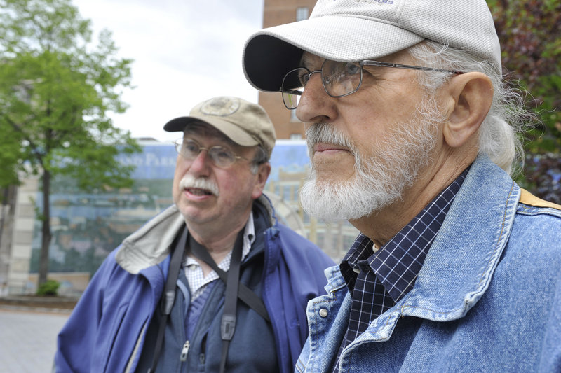 Landscape architect Anthony Muench, left, and his friend Charles Alden, a retired urban planner, visited the park recently and said the public space has value to the city and could be improved by altering its design.
