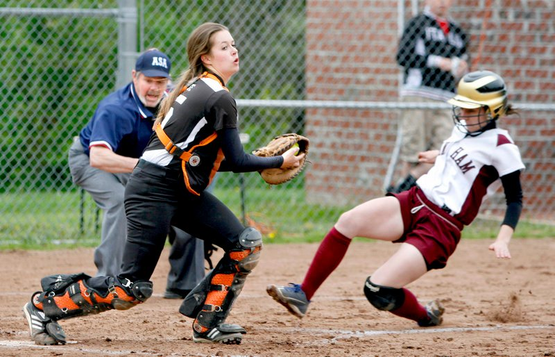 Biddeford catcher Katie Plante steps on the plate for a fcrceout as Haley Plante of Windham slides during their SMAA softball game Friday. Biddeford won, 5-2.